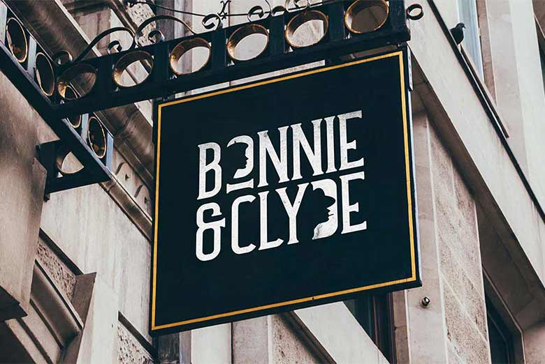 Image shows the branding for Bonnie & Clyde on a hanging sign