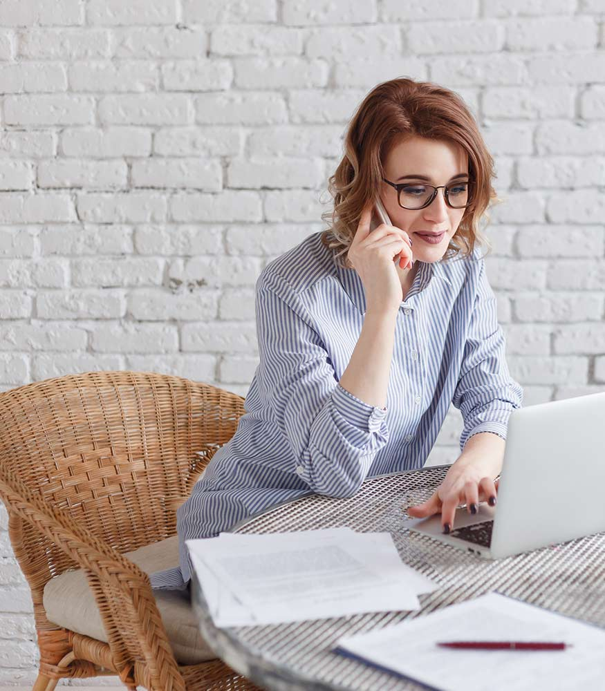 women looking at insurance website online